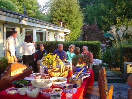 Rotarians enjoy a backyard party to welcome new members